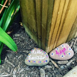 Inspirational rocks at the base of the Little Red Mailbox